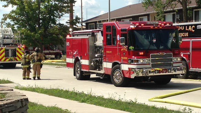 City of Fond du Lac Fire/Rescue respond to an apartment building fire at 143 West Division Street Thursday.