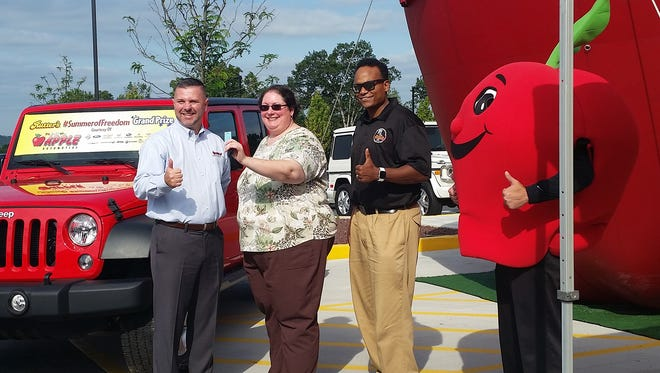From left, are: Mike King from Apple, Rebecca Zebley the Grand Prizewinner, Derek Gaskins from Rutter's, and Slice.