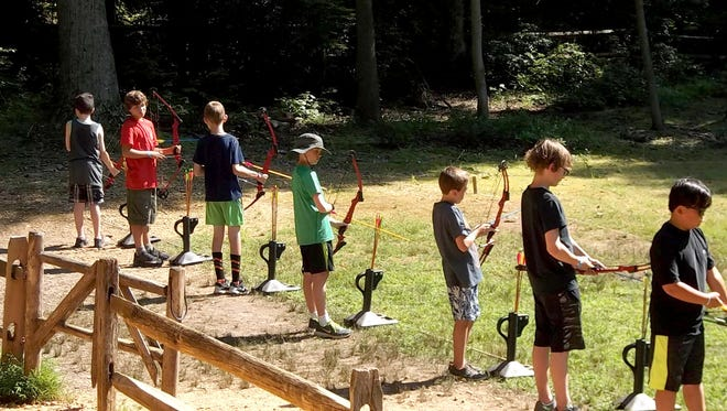 Scouts of Troop 103 of St. Joseph, Hanover, Isaac Roth, Parker Horak, Matthew Nawn and Kaleb Rigler are shown competing against Scouts from other troops.