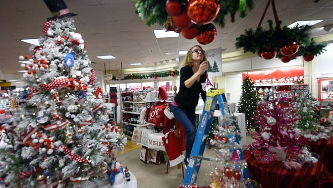 After World War II, The Bon-Ton opened retail stores outside York's downtown particularly in the 1960s. Here's one. Jill Redmond, a visual coordinator at the Bon-Ton, assembles Christmas decorations at the company's store in the York Galleria.
