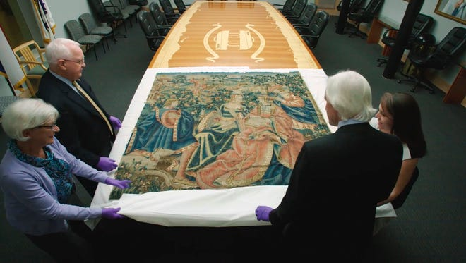 This Nov. 7, 2016 image from video provided by HISTORY Canada & More4 shows a 16th century tapestry at the National WWII Museum in New Orleans that had been in Adolf Hitler's retreat in the Bavarian Alps. (HISTORY Canada & More4 via AP)