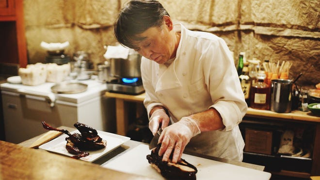"""Nobuo Fukuda is shown cooking in this scene from """"Kakehashi: A Portrait of Chef Nobuo Fukuda,"""" a documentary from Andrew Gooi of Food Talkies, about the acclaimed James Beard award-winning chef behind Nobuo at Teeter House in Phoenix."""