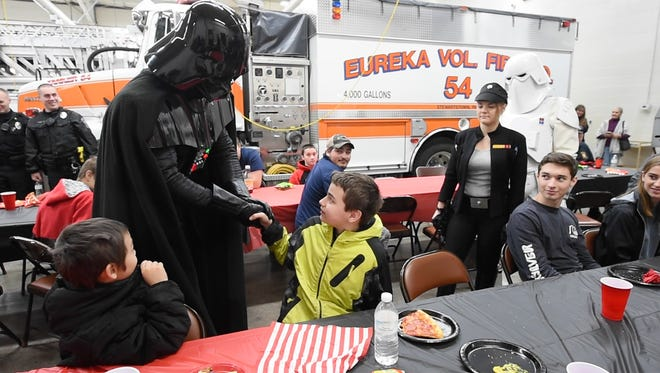 Darth Vader, played by Frank Bedo, left, shakes hands with Zach Foller during Foller's surprise birthday party at Eureka Fire Co in Stewartstown Sunday January 22, 2017.