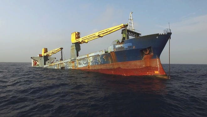 In this Jan. 20, 2017 photo provided by the Texas Parks and Wildlife Department, a former cargo vessel named Kraken sinks more than 60 miles off the coast of Galveston, Texas, to become an artificial reef. The ship is expected to become a home to fish, coral and other invertebrates plus being a destination for divers.