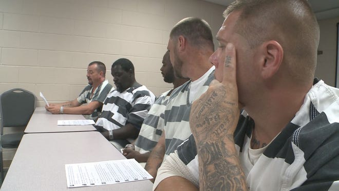 Inmates from Polk County, Ga., who saved a deputy who passed out, read and listen to some of the supportive comments written about their good deed Thursday, June 22, 2017.