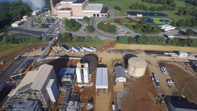 This is an aerial view of the Perdue AgriBusiness soybean processing plant in Conoy Township, Lancaster County, at bottom. At top is the Lancaster County Sold Waste Management Authority's waste-to-energy facility built in 1991, which will provide steam to dry and process soy beans.