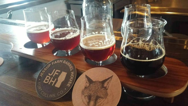 Stephen Adams and Soren Nicholson sampled a flight from 19 Fort Collins craft breweries in a 48-hour beer tour including this stop at Jessup Farm Barrel House.