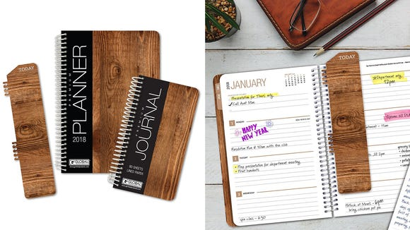 A planner and journal in one with a natural wooden