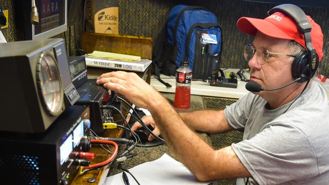 Ham radio operator Paul McCasland of Lafayette sits at the controls during the Acadiana Amateur Radio Association's 2016 Field Day.