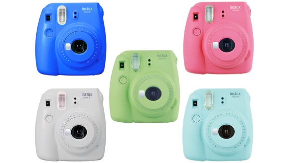 Get back to tradition with an instant camera.