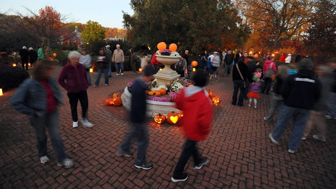 Visitors enjoy walking the grounds during the Pumpkin Glow at Kingwood in 2012.