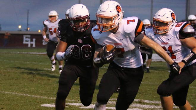 MTCS' Lucas Dale tries to outrun an Ezell-Harding defender Friday.