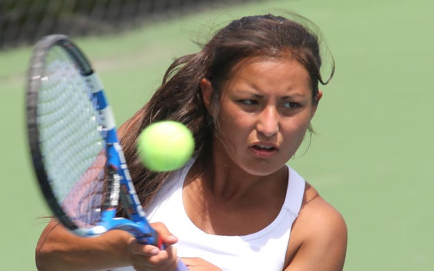 Greenwood's Kawamoto hits a return at the IHSAA girls tennis finals in singles and doubles play Saturday June 14, 2014 at Park Tudor High School.