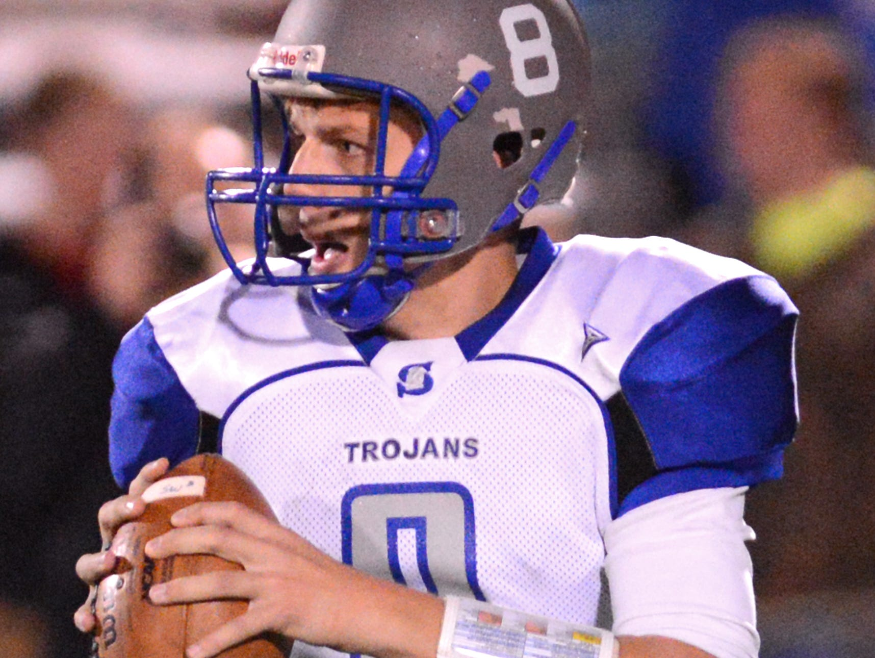 Green Bay Southwest quarterback Clayton Ladsten rolls out during the game against De Pere, Friday, October 10, 2014.