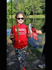 Laura Kennedy with her big catch at Fairview's annual