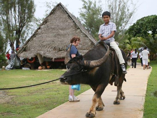 10 year old Roby Jay Tenorio of Talofofo rides a carabao