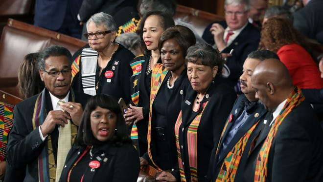 Members of Congressional Black Caucus wear black clothing and Kente cloth in protest ahead of a State of the Union address in the chamber of the US House of Representatives in Washington, DC, on January 30, 2018.