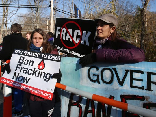Anti-fracking protesters Lana Guardo and Jessica Roff, both of Brooklyn, wait for Gov. Andrew Cuomo to arrive to vote at the Presbyterian Church of Mount Kisco Nov. 4, 2014. The state later determined that fracking would not be broadly permitted in New York.
