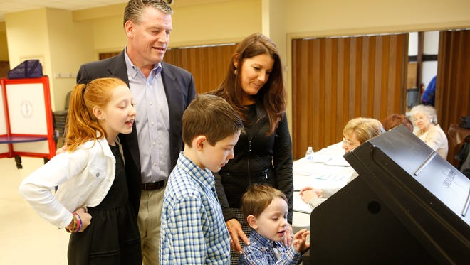 Terrence Murphy, Republican candidate for the 40th state Senate, with his wife, Caroline, daughter, McKayla, 12, and sons, Jack, 10, and Kian, 4, enter their ballots Tuesday at Jefferson Owners Corp. in Yorktown. Murphy won the state Senate seat.