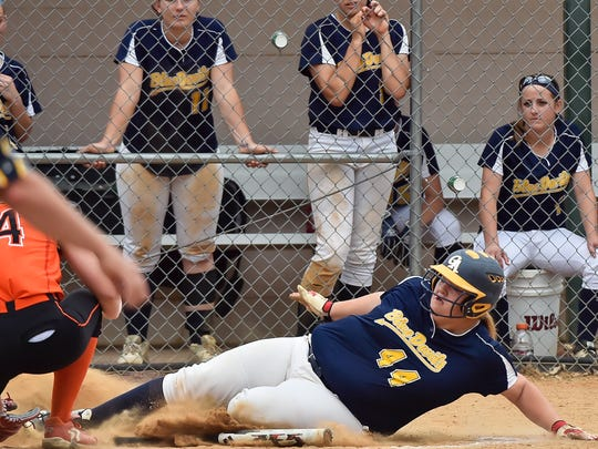 Greencastle's Alicen Hoover slides into homeplate as Cailey Joyce tries to tag her out during a District 3 Class AAA quarterfinal softball game against East Pennsboro on Thursday, May 26, 2016 at Carlisle, Pa. Greencastle defeated East Pennsboro 10-4.