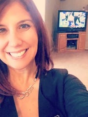 Patti Giunta Thayer at Sunday's open house in Greece with Bills game on