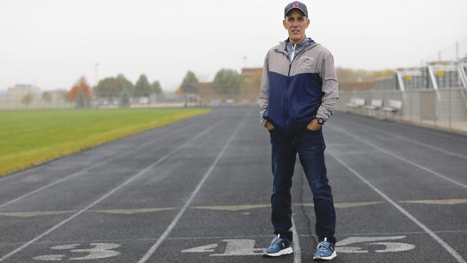 Former Belvidere and Belvidere North head track and field and cross country coach Troy Yunk on the track at Belvidere North on Friday.