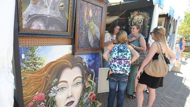 Taffie Garsee's vendor booth at the 2014 Red River Revel in Festival Plaza in downtown Shreveport. Garsee will return for the 40th anniversary to sell her paintings.