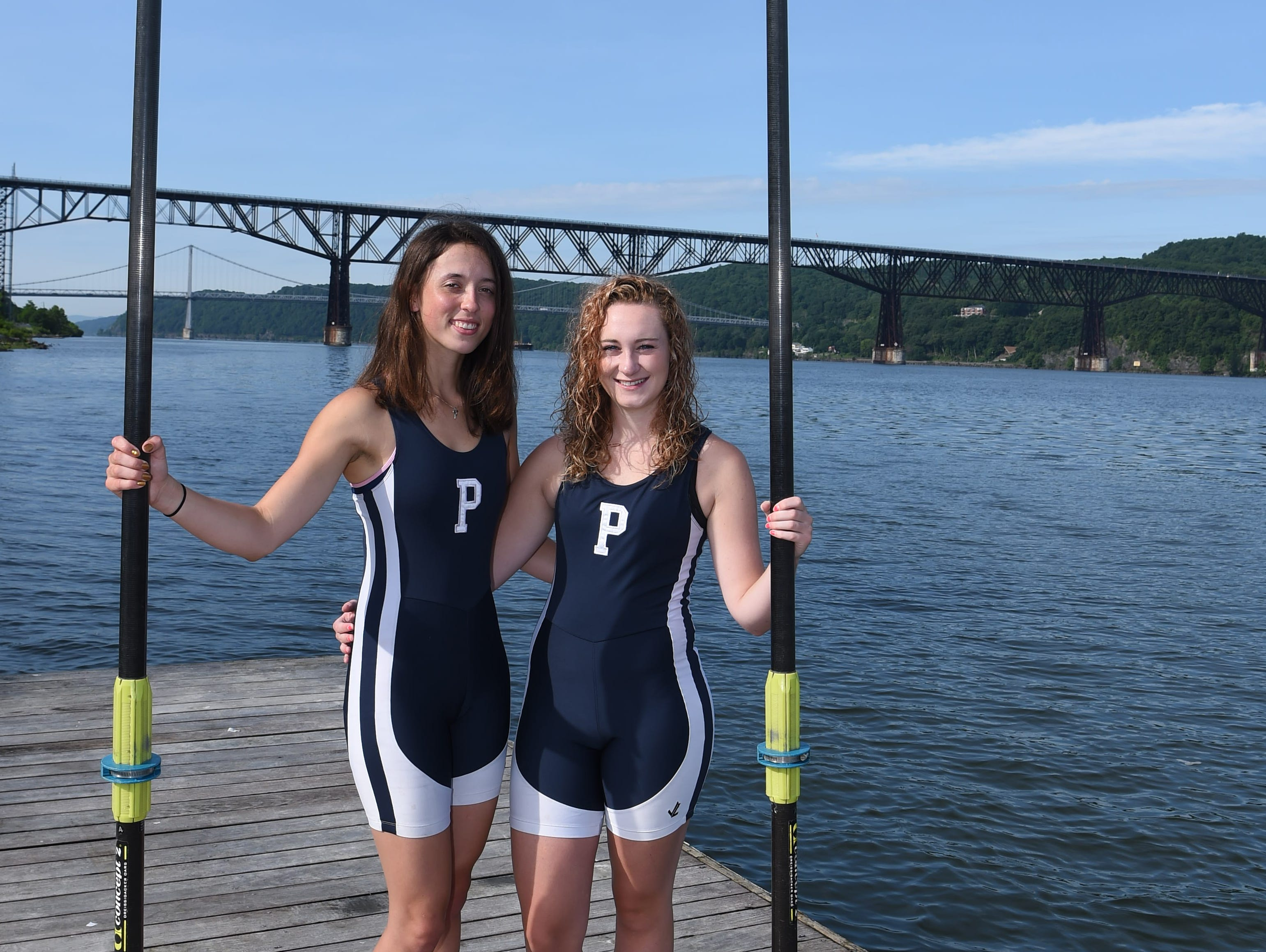 Fiona Mauer, left, 17, and Devin Tully, right, 18, both from the City of Poughkeepsie and graduates of Poughkeepsie High School, pose on the Hudson River. They make up the Girls Crew Boat of the Year.