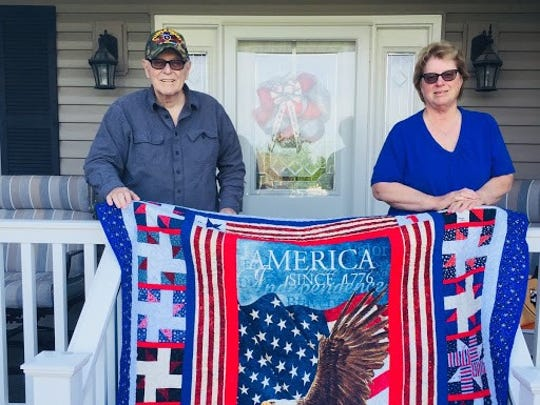 Don and Joan Flayler hold the Quilt of Valor awarded to Don for his military service