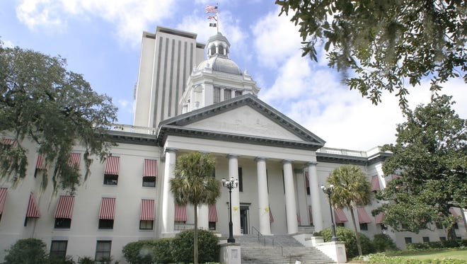 Historic Florida capitol building and current capitol building in the background.