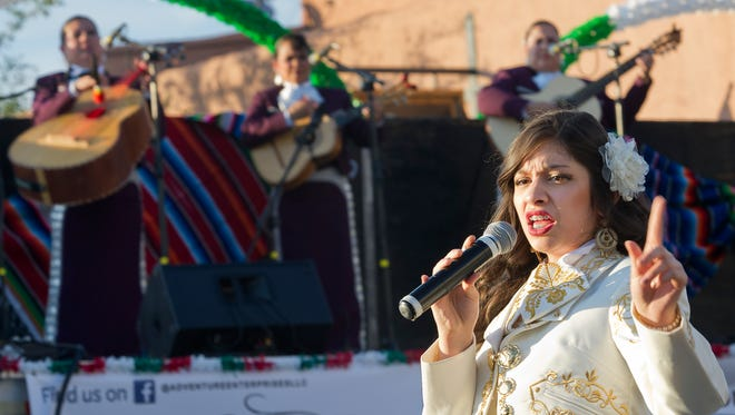 Alyssa Bustillos, of Las Cruces, performs at a street festival on Main Street in Downtown Las Cruces Saturday night, June 4, 2016, as part of the Las Cruces International Mariachi Conference.