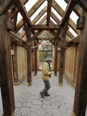 Owen Christianson walks through the replica of a Viking-era house he built as it was being reassembled at the University of Wisconsin-Green Bay. Christianson and his wife, Elspeth, donated the house to the university, where it will be  by the history department.