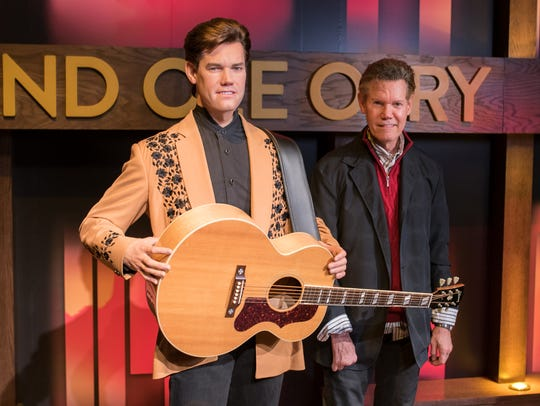 Randy Travis stands with his new wax figure at Madame