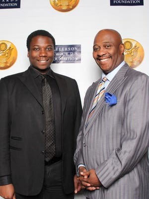 Norman Oliver stands with his son, Norman Oliver Jr., at the Jefferson Awards on Wednesday night.