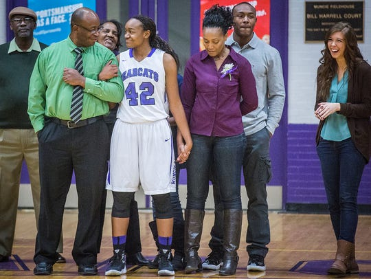 Central's Jayla Scaife is joined by family members