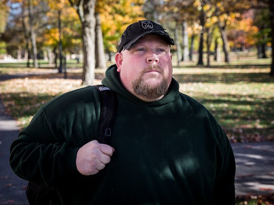 Iraq war veteran Patrick Weber heads to his next class in the West Quad at Ball State Thursday afternoon.