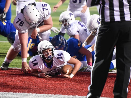 Albany's Austin Olmscheid looks to an official for a touchdown call during the first half of the Friday, Sept. 29, game at Husky Stadium in St. Cloud.