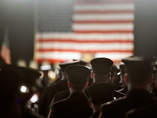 Firefighters arrive for a public memorial service honoring