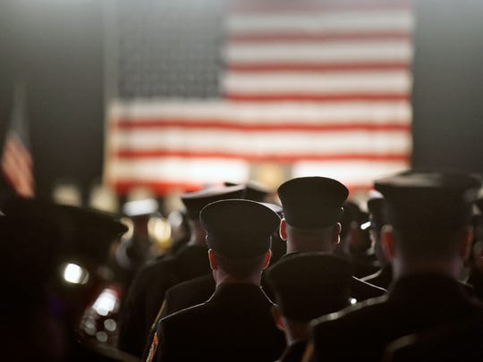 Firefighters arrive for a public memorial service honoring York City firefighters Ivan Flanscha and Zachary Anthony Wednesday, March 28, 2018, at the York Expo Center. Flanscha and Anthony were killed in the line of duty Thursday, March 22, 2018, while containing hot spots the day after a three-alarm fire consumed the old Weaver Organ and Piano building in York.