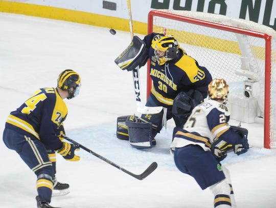 Michigan goalie Hayden Lavigne (30) makes a save during