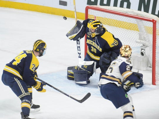 Michigan goalie Hayden Lavigne (30) makes a save during the first period Notre Dame in the 2018 Frozen Four college hockey national semifinals at Xcel Energy Center on April 5, 2018.