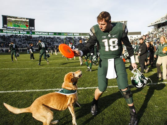 Michigan State quarterback Connor Cook tossed a Frisbee