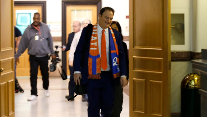 FC Cincinnati general manager Jeff Berding leaves the building after the funding proposal passes during a meeting of the City Council finance committee at City Hall in downtown Cincinnati on Monday, Nov. 27, 2017. The finance committee met Monday to hear from community members and cast a vote on a funding plan for FC Cincinnati's soccer-specific stadium.
