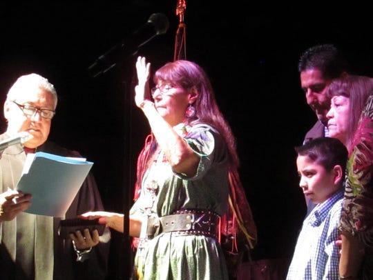 As her family watches, Helen Klinekole is sworn into