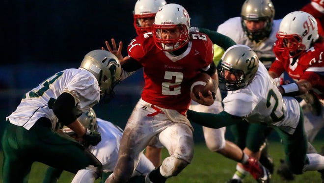 Hortonville's Mitch Gerhartz carries the ball during a VFA-South game against Oshkosh North on Sept. 12 at Hortonville.