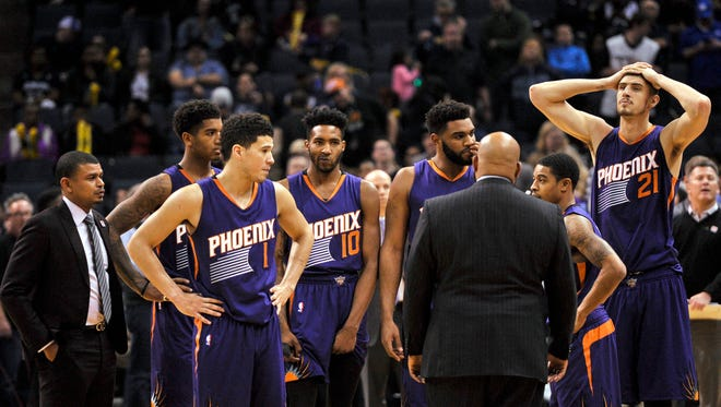 The Phoenix Suns huddle with head coach Earl Watson during the second half against the Memphis Grizzlies. Memphis defeated Phoenix 110-91.