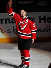 FILE - In this Jan. 6, 2015, file photo, New Jersey Devils' Patrik Elias, of the Czech Republic, takes a curtain call after an NHL hockey game where Elias recorded his 1,000 career point, against the Buffalo Sabres, in Newark, N.J. Devils' all-time leading scorer Patrik Elias is retiring after a career that spanned almost two decades and included two Stanley Cup titles. The 40-year-old native of the Czech Republic announced his retirement in a statement on Friday, March 31, 2017.  (AP Photo/Julio Cortez, File)