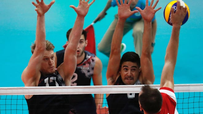From left, Maxwell Holt and Taylor Sander have given the Americans a boost in men's volleyball. After an 0-2 start, the U.S. is headed to the semifinals Friday.