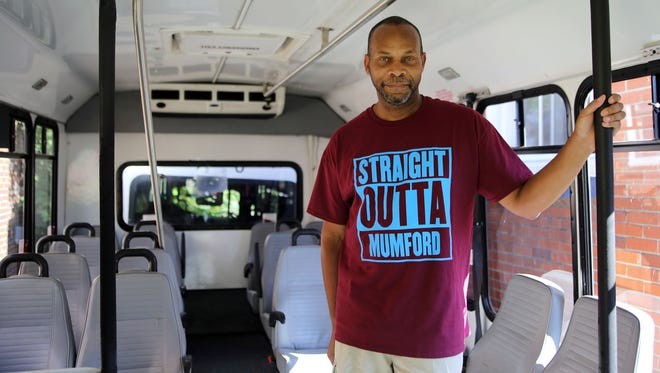 Michael Williams of Detroit shows off his recently purchased SMART bus he wants to turn into a mobile museum about Detroit Public Schools.