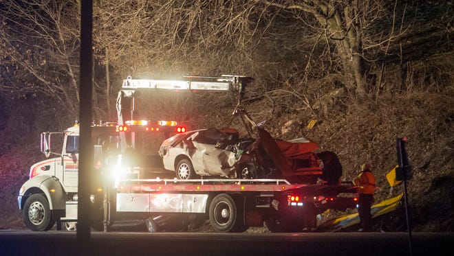 A badly damaged car is loaded onto a flatbed towtruck at the scene of an accident with several injuries at the intersection of Cool Creek Road and Mt. Pisgah Road in Hellam Township on Monday.